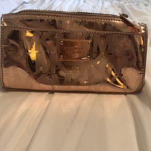 Michael Kors clutch, makeup case.